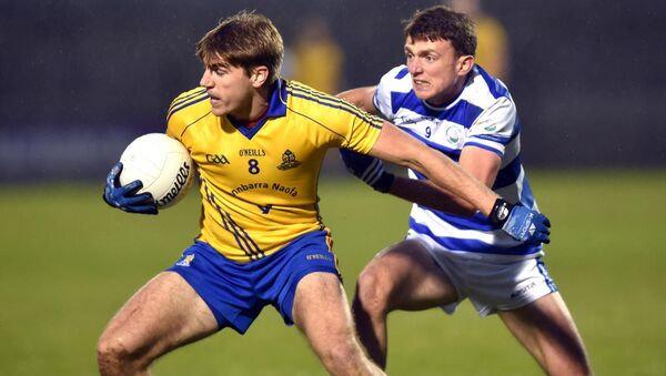St Finbarr's Ian Maguire breaks from Castlehaven's Mark Collins during the Bon Secours Cork SFC semi-final Páirc Uí Rinn. Picture: Eddie O'Hare