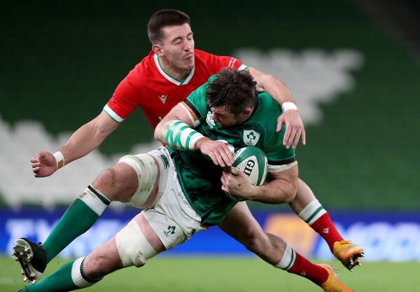 Peter O'Mahony with Josh Adams of Wales. Picture: INPHO/Dan Sheridan