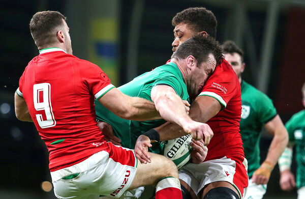Ireland's Cian Healy is tackled by Taulupe Faletau and Gareth Davies of Wales. Picture: INPHO/Laszlo Geczo