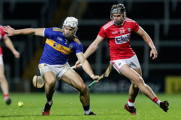 Tipperary's Niall O'Meara and Darragh Fitzgibbon of Cork. Picture: INPHO/Laszlo Geczo