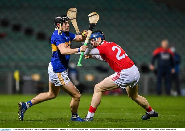 Alan Flynn of Tipperary is tackled by Conor Lehane. Picture: Brendan Moran/Sportsfile