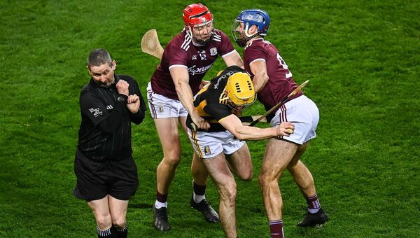 Richie Leahy of Kilkenny in action against Joe Canning and Johnny Coen of Galway as referee Fergal Horgan gets out of the way. Picture: Harry Murphy/Sportsfile