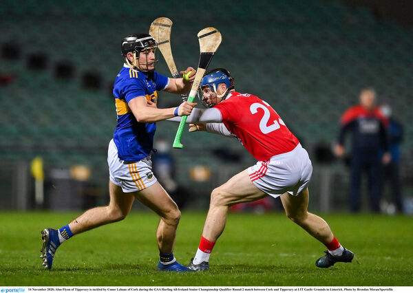 Alan Flynn of Tipperary is tackled by Conor Lehane of Cork in the hurling qualifier defeat. Picture: Brendan Moran/Sportsfile