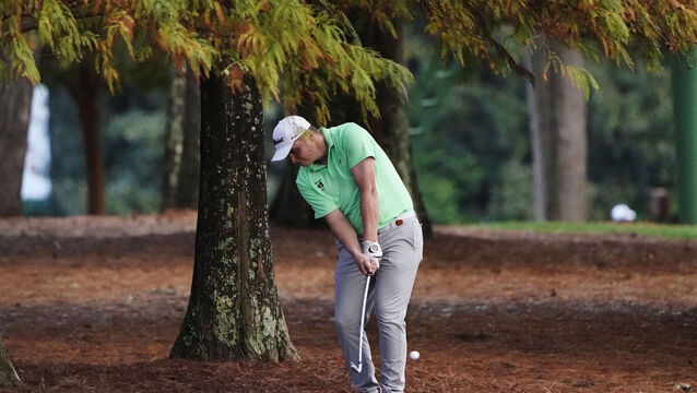 <p>James Sugrue, of Ireland, hits out of the rough on the 13th hole during the first round of the Masters golf tournament Thursday, Nov. 12, 2020, in Augusta, Ga. (AP Photo/Chris Carlson)</p>