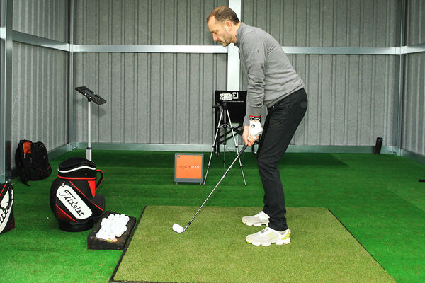 David O'Sullivan practicing with the help of Trackman in his swing room at the range in Cobh Golf Club. Picture: Niall O'Shea