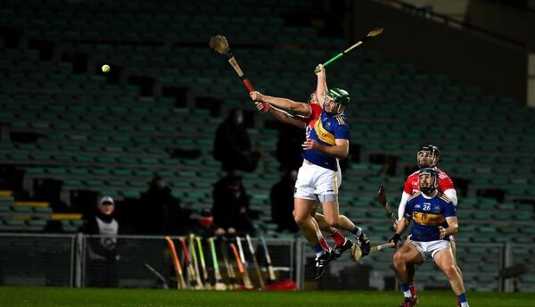 Bill Cooper of Cork and Noel McGrath of Tipperary compete for a dropping ball in front of empty stands during the GAA Hurling All-Ireland Senior Championship Qualifier Round 2 match between Cork and Tipperary at LIT Gaelic Grounds in Limerick. Photo by Brendan Moran/Sportsfile