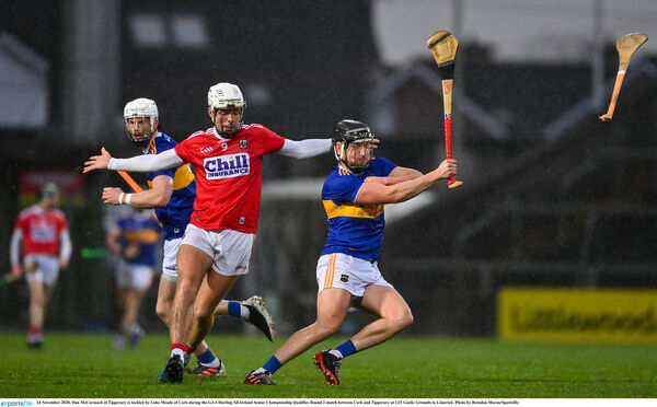 Dan McCormack of Tipperary is tackled by Luke Meade of Cork during the GAA Hurling All-Ireland Senior Championship Qualifier Round 2 match between Cork and Tipperary at LIT Gaelic Grounds in Limerick. Photo by Brendan Moran/Sportsfile