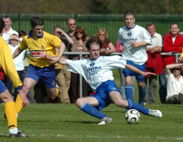 Blarney United's Cormac Hayes going low to clear the ball from Carrigaline at O'Shea Park. Picture: Richard Mills.