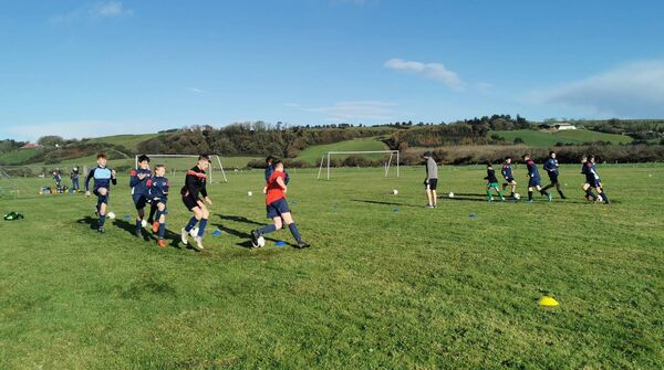 Some of the 2021 West Cork Schoolboys League Kennedy Cup squad training in small pods in Ballyvackey, home of Clonakilty soccer club, recently.