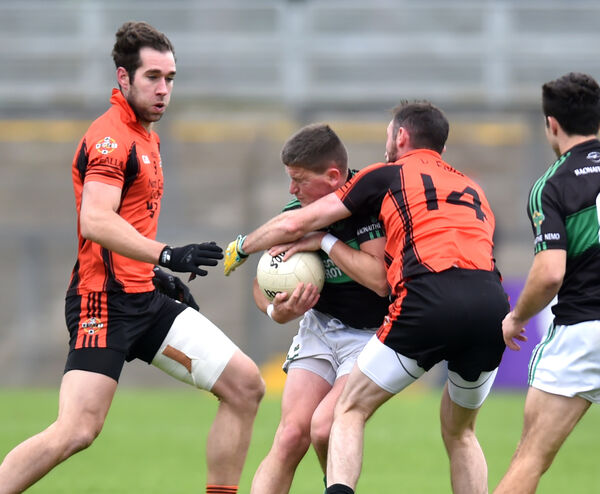Nemo Rangers' Colin O'Brien is tackled by Duhallow's Donncha O'Connor. Picture: Eddie O'Hare