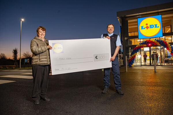 Lidl Store Manager Andrius Vasiliauskas pictured donating Û500 to Sr Helen of Mercy House.