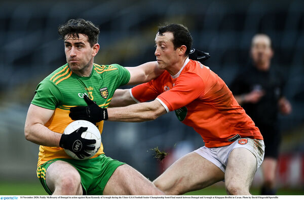 Paddy McBrearty of Donegal in action against Ryan Kennedy of Armagh. Picture: David Fitzgerald/Sportsfile