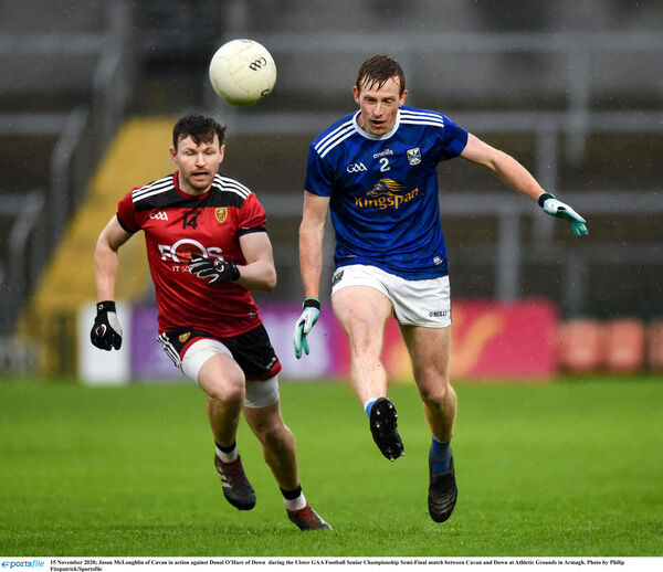 Jason McLoughlin of Cavan in action against Donal O'Hare of Down. Picture: Philip Fitzpatrick/Sportsfile