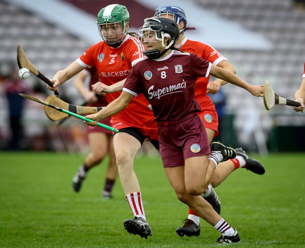 Galway's Aoife Donohue tackled by Hannah Looney and Izzy O'Regan. Picture: INPHO/Lorraine O'Sullivan