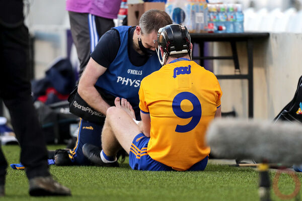 Tony Kelly receives medical attention. Picture: INPHO/Laszlo Geczo
