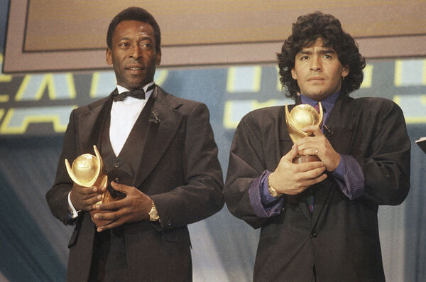 "Pele, left, and Maradona hold ""Sports Oscar"" trophies in Milan, Rome."