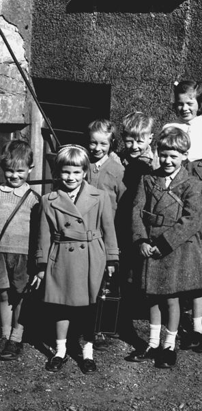 ALL SMILES: Children outside St Nicholas School in Cove Street, Cork city, on the day that it closed for good — October 2, 1957.