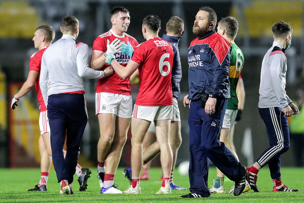 Cork's Mark Keane celebrates after the game with Sean Meehan. Picture: INPHO/Laszlo Geczo