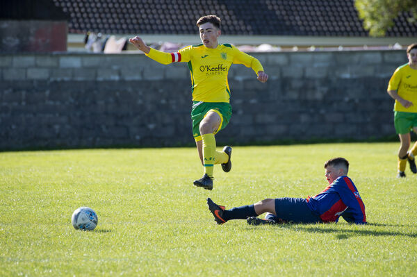 Conor Meaney, Rockmount, jumping the tackle of Springfield Ramblers' Charlie Morrissey during their U15 match at Pat O'Brien Park. Picture: Dan Linehan