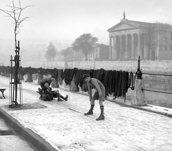 Skaters in short trousers during a winter cold snap on Lavitt's Quay, Cork, in 1937.