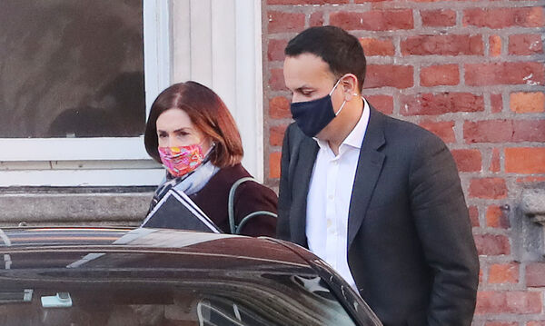 Tánaiste Leo Varadkar with Minister of State Hildegarde Naughton as they leave Dublin Castle after attending a Cabinet meeting.