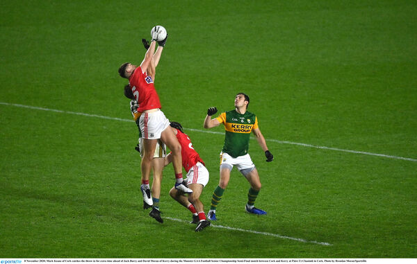 Mark Keane of Cork catches the throw-in for extra time ahead of Jack Barry and David Moran of Kerry. Picture: Brendan Moran/Sportsfile