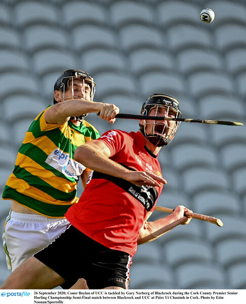 Conor Boylan of UCC is tackled by Gary Norberg of Blackrock. Picture: Eóin Noonan/Sportsfile