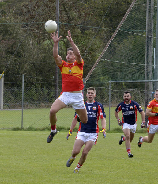 Éire Óg's Colm O'Shea rising high to take the ball. Picture Denis Boyle