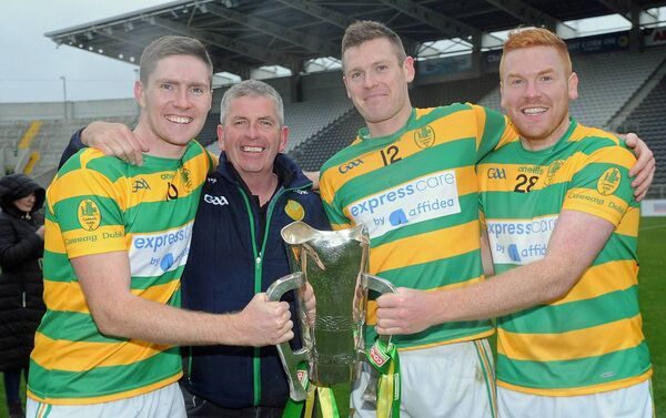The cup that cheers... Blackrock SH Selector Kieran O Keeffe with his sons Mark, Shane and Ian after the Premier SHC county final. Picture: George Hatchell