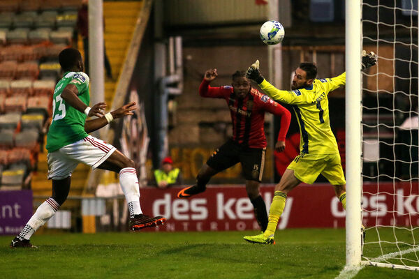 Bohemians' Andre Wright scores a goal past Mark McNulty. Picture: INPHO/Laszlo Geczo