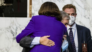Democratic senator condemned by allies for hugging Republican rival