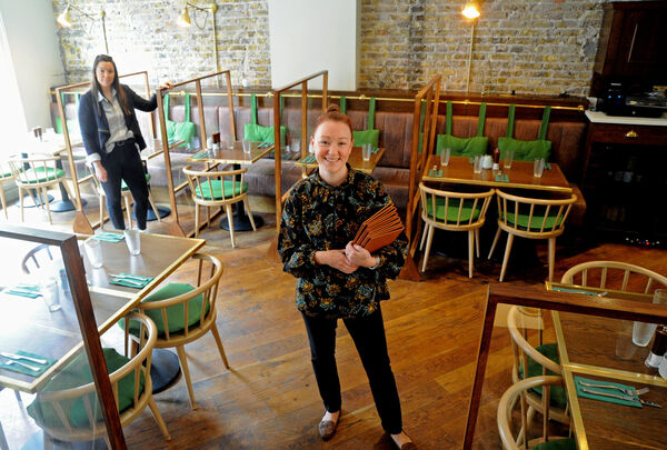 Laura Sureda, co-owner, (left) and Sarah Fitzgerald, restaurant manager, The SpitJack, which reopened with perspex screens for restaurant table service in accordance with guidelines at Washington Street, Cork, on Monday, June 29. Picture Denis Minihane.