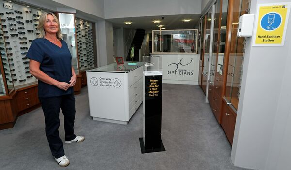 Clodagh Daly, John Daly Opticians, will continue to welcome customers to the store on an appointment basis only throughout Level 5 restrictions. Picture: Jim Coughlan.