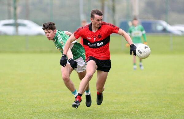 Colin English, Mitchelstown, gets away from Niall Barry-Murphy, Aghabullogue. Picture: Jim Coughlan.