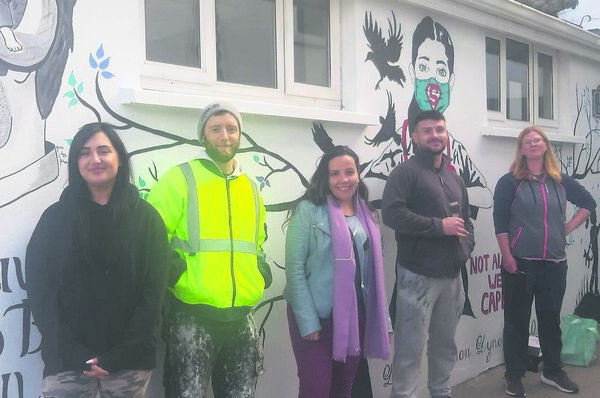 MANY HANDS MAKE GREAT WORK: Larna, Desmond, Rosanna, Jamie and Eimbim were among those pitching into the art project. BELOW: Useful numbers in the mural, which aims to raise awareness of mental health