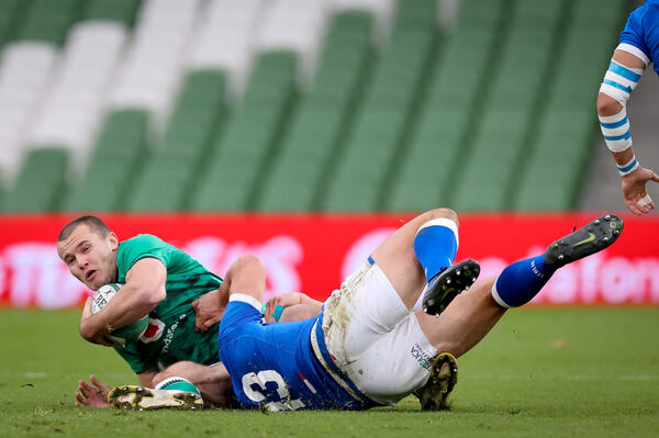 Ireland's Jacob Stockdale is tackled by Carlo Canna and Luca Morisi of Italy. Picture: INPHO/Billy Stickland