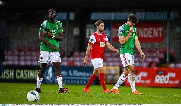 Joseph Olowu, left, and Gearóid Morrissey of Cork City leave the field dejected following the loss to St Pat's. Picture: Sam Barnes/Sportsfile