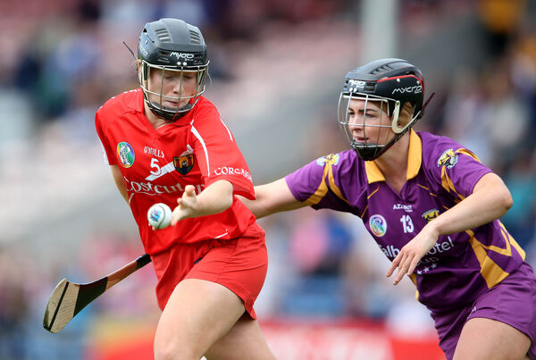 Cork's Laura Tracey and Ursula Jacob of Wexford Mandatory Credit ©INPHO/Cathal Noonan