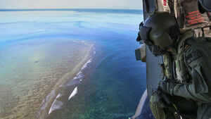 Australian navy tows unexploded bomb away from reef