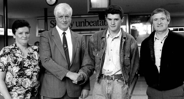 Roy Keane shakes hands with John O'Rourke, chairman, Cobh Ramblers, included are Roy's parents Mossie Keane and Marie Keane.