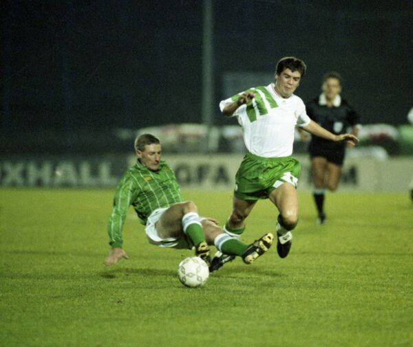 Roy Keane is brought down by Nigel Worthington at Windsor Park in 1993. Picture: Eddie O'Hare