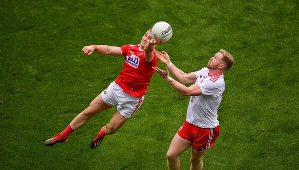 Mattie Taylor in action against Frank Burns of Tyrone. Picture: Seb Daly/Sportsfile