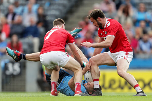 Dublin's Con O'Callaghan is tackled by Mattie Taylor an James Loughrey. Picture: INPHO/Laszlo Geczo