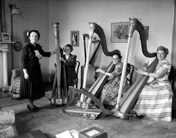 Harp school at MacCurtain Street. On the right is Shiela MacCurtain, daughter of Tomás MacCurtain, 1953.
