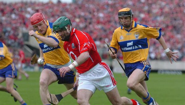 Cork's Jerry O'Connor racing past Clare's Brian Lohan, who is now their manager. Picture: Eddie O'Hare
