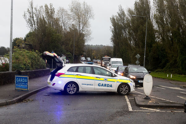 Carrigaline, Cork, Ireland. 20th October, 2020. Gardai on duty as major diversions were in place as a result of high tides which flooded the Crosshaven road and the town center of Carrigaline, Co. Cork, Ireland- Picture; David Creedon / Anzenberger
