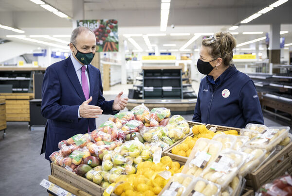 Pictured at the national announcement of the creation of 1,150 new jobs by Tesco Ireland, An Taoiseach Micheál Martin T.D. meets Louise O'Keefe, one of the many colleagues redeployed to other stores in Cork during the yearlong closure who are now back in store, preparing to welcome customers in line with Covid-19 safety protocols.