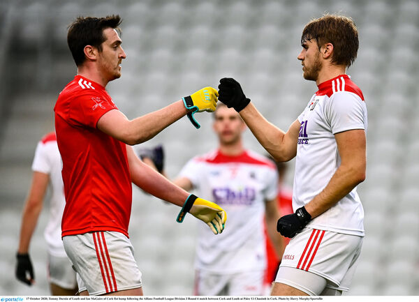 Tommy Durnin of Louth and Ian MaGuire of Cork fist bump after. Picture: Harry Murphy/Sportsfile