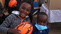 Children in direct provision take up rugby in Cork town