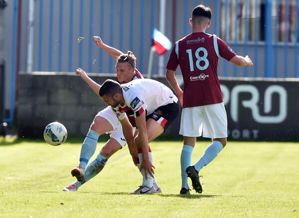 Cobh Ramblers' Ian Turner clears from Dundalk's Michael Duffy during the FAI Cup tie at St Colman's Park. Picture: Eddie O'Hare